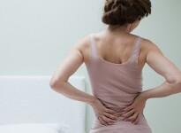 Боли в пояснице при беременности: естественные и опасные причины